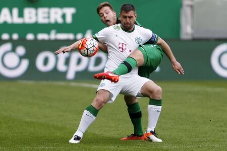 bode: BUDAPEST, HUNGARY - APRIL 6, 2016: Daniel Bode of Ferencvaros (r) covers the ball from Kristof Papp of Paks during Ferencvaros - Paks OTP Bank League football match at Groupama Arena. Editorial