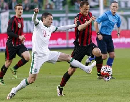 teammate: BUDAPEST, HUNGARY - APRIL 10, 2016: Vladan Cukic of Ferencvaros (l) duels for the ball with Marton Eppel of Honved during Ferencvaros - Budapest Honved OTP Bank League football match at Groupama Arena. Editorial