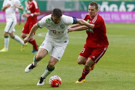 bode: BUDAPEST, HUNGARY - APRIL 13, 2016: Daniel Bode of Ferencvaros (l) duels for the ball with Mihaly Korhut of DVSC during Ferencvaros - DVSC Hungarian Cup semi-final football match at Groupama Arena. Editorial