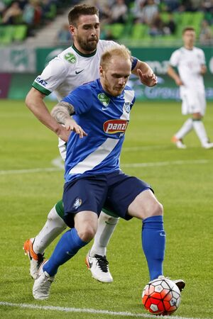 bode: BUDAPEST, HUNGARY - APRIL 16, 2016: Daniel Bode of Ferencvaros (l) duels for the ball with Patrik Poor of MTK Budapest during Ferencvaros - MTK Budapest OTP Bank League football match at Groupama Arena.