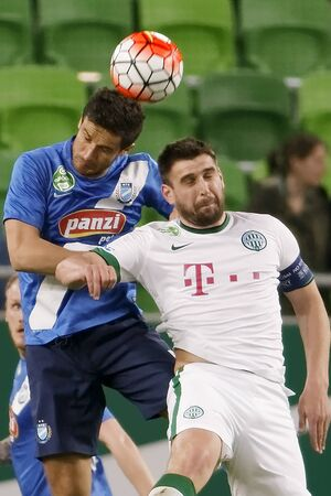 bode: BUDAPEST, HUNGARY - APRIL 16, 2016: Daniel Bode of Ferencvaros (r) duels for the ball with Mato Grgic of MTK Budapest during Ferencvaros - MTK Budapest OTP Bank League football match at Groupama Arena. Editorial