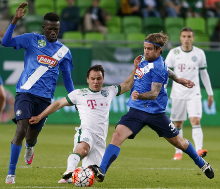 BUDAPEST, HUNGARY - APRIL 16, 2016: Tamas Hajnal of Ferencvaros fights for the ball with Adam Vass (r) and Thiam Khaly Iyane of MTK Budapest during Ferencvaros - MTK Budapest OTP Bank League football match at Groupama Arena. Sajtókép