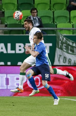 bode: BUDAPEST, HUNGARY - APRIL 16, 2016: Daniel Bode of Ferencvaros (l) battles for the ball in the air with Daniel Gera of MTK Budapest during Ferencvaros - MTK Budapest OTP Bank League football match at Groupama Arena.