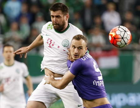 bode: BUDAPEST, HUNGARY - APRIL 23, 2016: Daniel Bode of Ferencvaros (l) battles for the ball in the air with Robert Litauszki of Ujpest during Ferencvaros - Ujpest OTP Bank League football match at Groupama Arena. Editorial