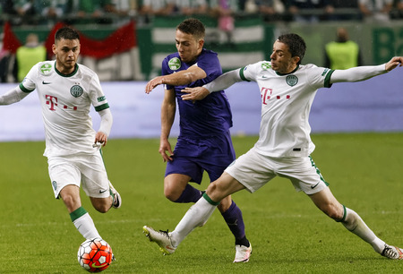 break out: BUDAPEST, HUNGARY - APRIL 23, 2016: Kylian Hazard of Ujpest tries to break out between Andras Rado (l) and Vladan Cukic (r) of Ferencvaros during Ferencvaros - Ujpest OTP Bank League football match at Groupama Arena.
