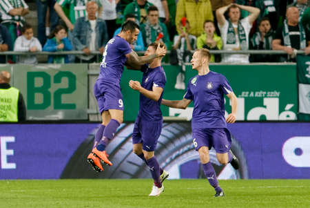 BUDAPEST, HUNGARY - APRIL 23, 2016: Laszlo Lencse (l) of Ujpest celebrates his goal with Balazs Balogh and Benjamin Cseke (r) during Ferencvaros - Ujpest OTP Bank League football match at Groupama Arena.