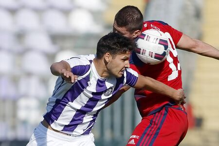 patrik: BUDAPEST, HUNGARY - APRIL 30, 2016: Akos Kecskes of Ujpest (l) battles for the ball in the air with Patrik Tischler of Videoton during Ujpest - Videoton OTP Bank League football match at Szusza Stadium.