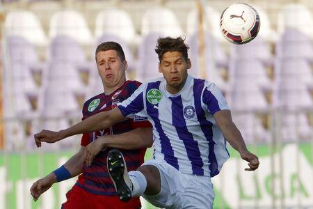 patrik: BUDAPEST, HUNGARY - APRIL 30, 2016: Akos Kecskes of Ujpest (r) fights for the ball with Patrik Tischler of Videoton during Ujpest - Videoton OTP Bank League football match at Szusza Stadium.