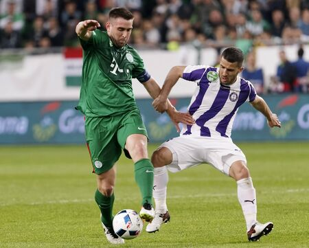 bode: BUDAPEST, HUNGARY - MAY 7, 2016: Bojan Sankovic (R) of Ujpest FC fights for the ball with Daniel Bode (L) of Ferencvarosi TC during the Hungarian Cup Final football match between Ujpest FC and Ferencvarosi TC at Groupama Arena on May 7, 2016 in Budapest,  Editorial