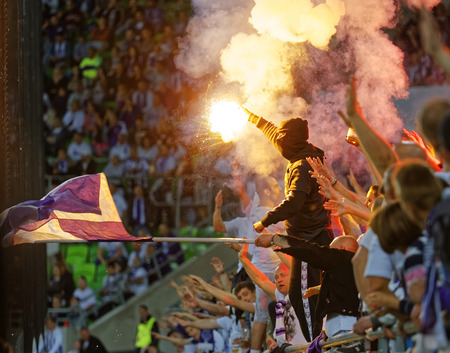 ultras: BUDAPEST, HUNGARY - MAY 7, 2016: Ultra fans of Ujpest FC light fire during the Hungarian Cup Final football match between Ujpest FC and Ferencvarosi TC at Groupama Arena on May 7, 2016 in Budapest, Hungary.