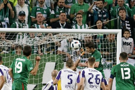 teammate: BUDAPEST, HUNGARY - MAY 7, 2016: Zoltan Gera (R up) of Ferencvarosi TC heads the winning goal during the Hungarian Cup Final football match between Ujpest FC and Ferencvarosi TC at Groupama Arena on May 7, 2016 in Budapest, Hungary.