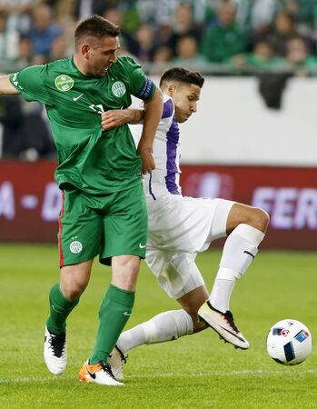 bode: BUDAPEST, HUNGARY - MAY 7, 2016:  Akos Kecskes (R) of Ujpest FC duels for the ball with Daniel Bode (R) of Ferencvarosi TC during the Hungarian Cup Final football match between Ujpest FC and Ferencvarosi TC at Groupama Arena on May 7, 2016 in Budapest, Hu