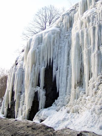 rock covered by icicle