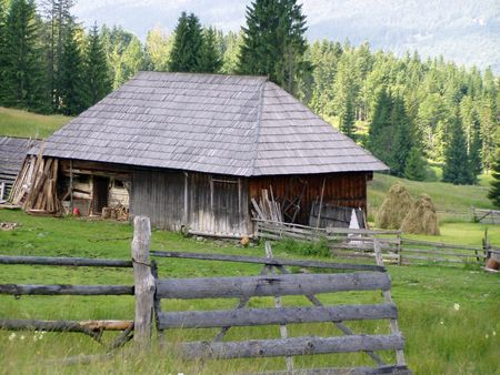 little wooden house in the mountains Stock Photo
