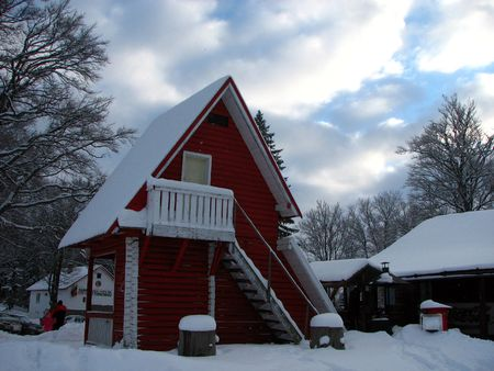 wooden house with snow in a beautiful winter landscape