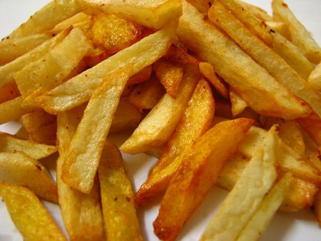 french fries close-up on white background