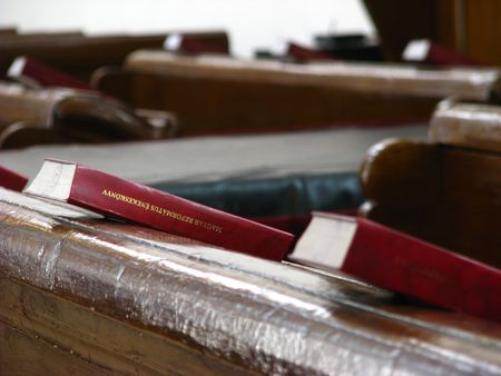 protestant church desk with bibles on it