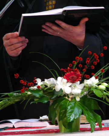 protestant priests hands with open bible