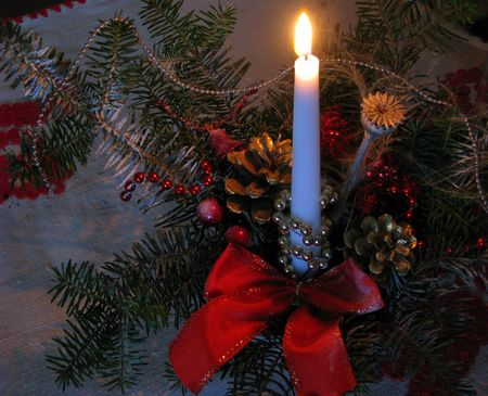 christmas ikebana with lit candle - landscape photo