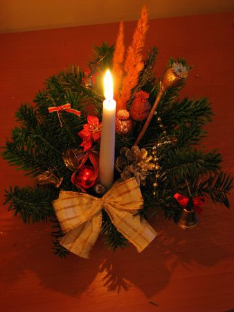 christmas decoration with lit candle - isolated photo