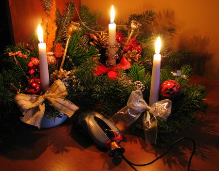 chrismas: three christmas decorations with mouse in the foreground - landscape Stock Photo