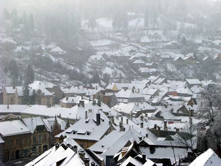 tranquille: snowy roofs in winter village Stock Photo