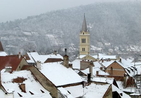 tranquille: quiet mountain village and church tower in winter