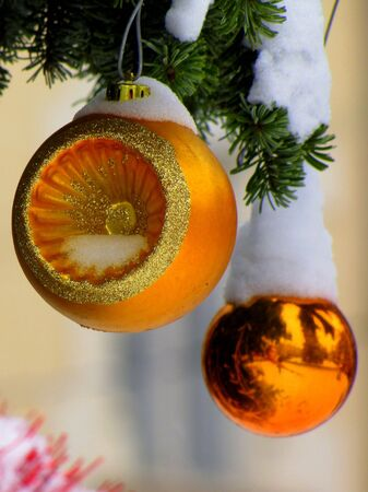 golden chirstmas ornaments in shallow DOF - portrait photo