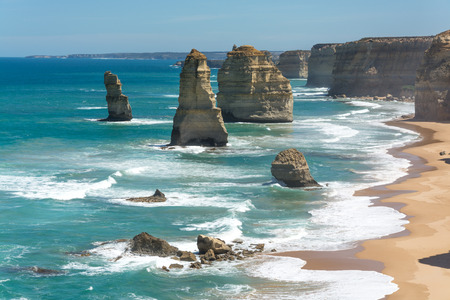 Cliff formations standing tall out of the sea by the coast - Great Ocean Road 12 apostles Australia Stock Photo