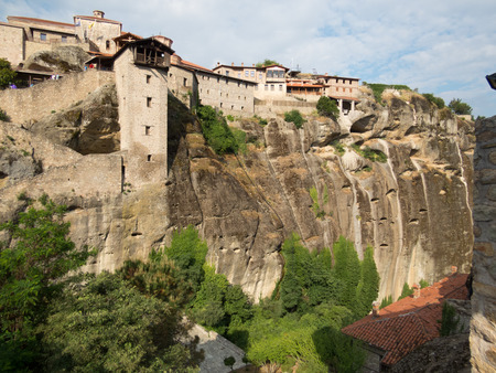 cliff top: Side view of Meteora cliff top monastery