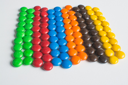 Pile of colorful chocolate bonbon candies on white background Stok Fotoğraf