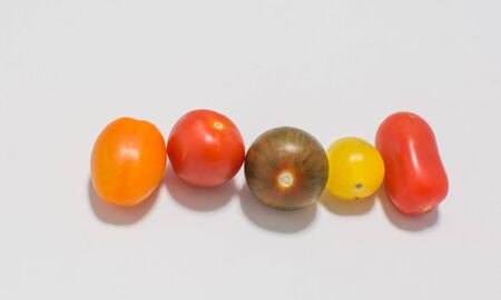 cherry varieties: Different varieties of cherry cocktail tomatoes on a white background Stock Photo