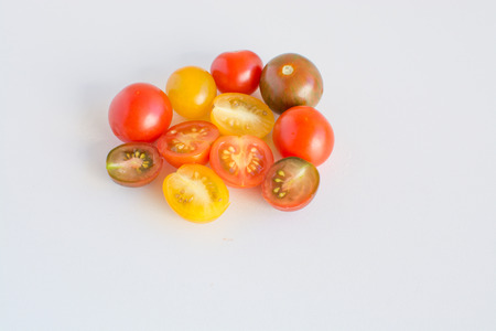 cherry varieties: Different varieties of cherry tomatoes on white background