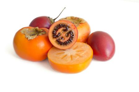 tomate de arbol: Exotic fresh persimon and tamarillo isolated on white background