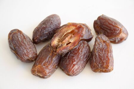 date fruit: Dried date fruit whole and cross section on a white background Stock Photo