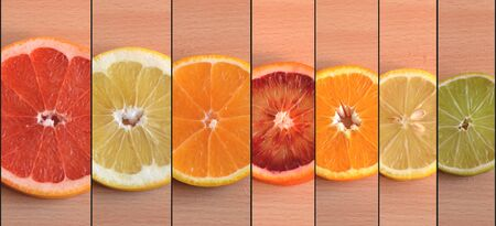 Slices of seven different citrus varieties arranged by size Stock Photo