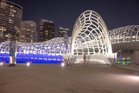 4 August 2016: Winter evening view of Webb Bridge in Melbournes Docklands. Used for walking and cycling, Webb bridge was developed in collaboration with artist Robert Owen Editorial