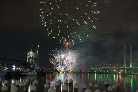 Fireworks display happening over Melbournes Docklands near Bolte Bridge
