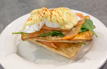 Eggs benedict with smoked salmon, spinach and ciabatta bread