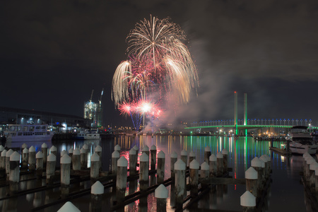 2016 August 5: Fireworks display happening over Melbournes Docklands near Bolte Bridge