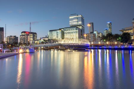 Winter evening view of Webb Bridge in Melbournes Docklands. Used for walking and cycling, Webb bridge was developed in collaboration with artist Robert Owen Stock Photo