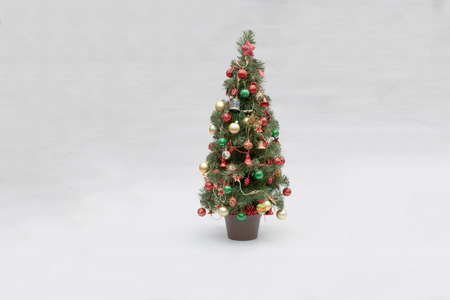 small decorated christmas tree on a light background stock photo 61624948