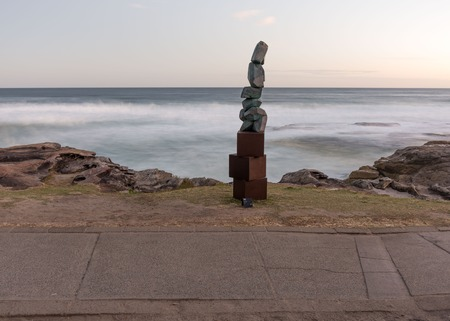5th of November 2016, Bondi Beach, Sydney, Australia. Sculpture titled Stack by Clara Hali with the motion-blurred sea in the background at Sculpture by the Sea at sunset Editorial