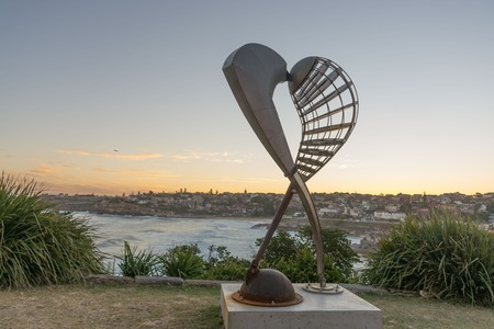 5th of November 2016, Bondi Beach, Sydney, Australia. Geoffrey Bartlett Embrace sculpture against the sunset at Sculpture by the Sea. Free annual event Editorial