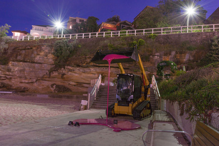 5th of November 2016, Bondi Beach, Sydney, Australia. Sculpture by Markus Hofer titled The tractor taken with long exposure during the Sculpture by the Sea event Editorial