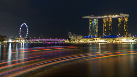 January 2017: night time cityscape of Singapore with light reflections in the water - built on reclaimed land Editorial