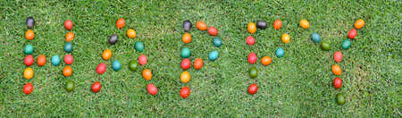 The word Happy written in colourful natural Easter Eggs - Easter Greeting Concept banner Stock Photo