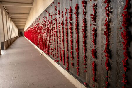 Canberra, ACT, Australia - Sept 1 2018: poppy decoration next to the wall of fallen soldiers at the Australian War Memorial - Lest we forget, Remembrance of war losses. Editorial