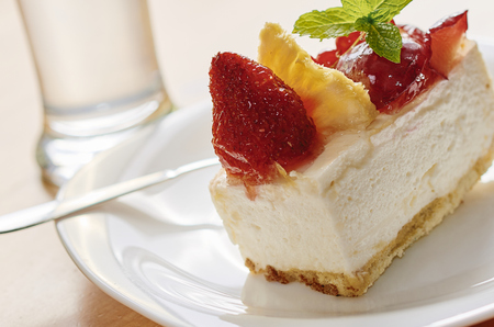 topping: Cheesecake with fruit topping Stock Photo