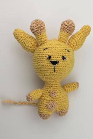 yellow yarn rabbit on white backgrund Stock Photo